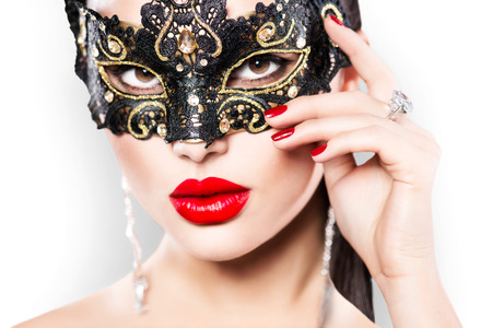 black mask: Beauty model woman wearing masquerade carnival mask