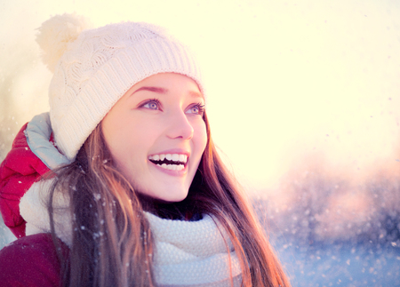 snow woman: Beauty winter girl outdoors in frosty winter park