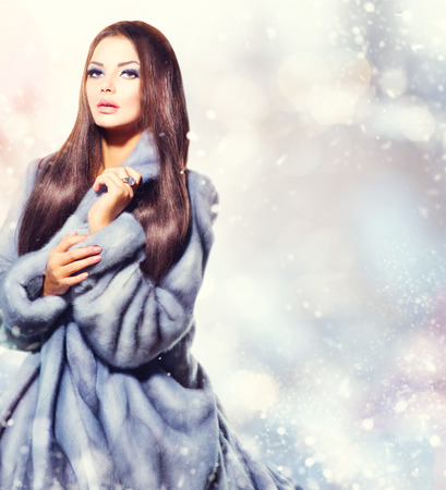 winter fashion: Beauty Fashion Model Girl in Blue Mink Fur Coat Stock Photo
