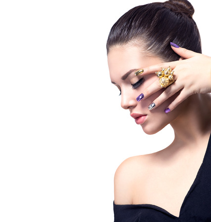 gold ring: Woman with colorful nails art