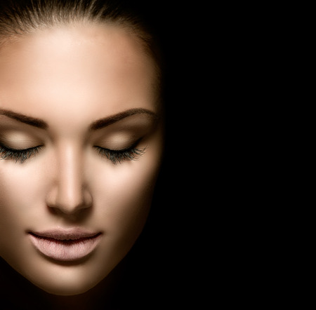 woman face close up: Beauty woman face closeup isolated on black background