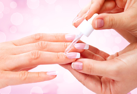 pink nail polish: Manicure, hands spa cuticle oil. Beautiful woman hands closeup Stock Photo