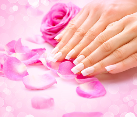pink nail polish: Manicure, Hands spa. Female hands, soft skin, beautiful nails Stock Photo