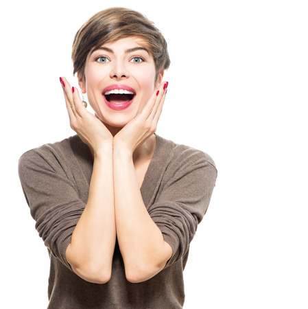 Surprised woman. Young excited beauty with short hairstyle photo