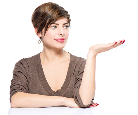 Young woman showing empty copy space on the open hand palm photo