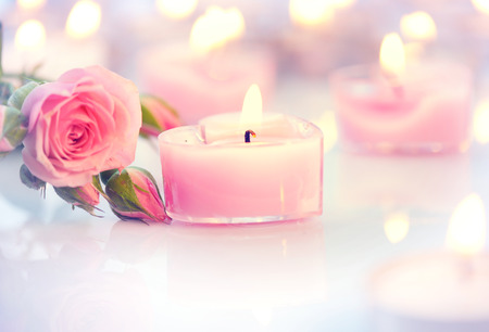 Valentines Day. Pink heart shaped candles and rose flowers photo