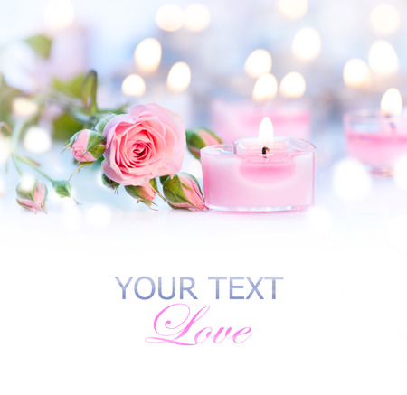 table: Valentines Day. Pink heart shaped candles and rose flowers Stock Photo