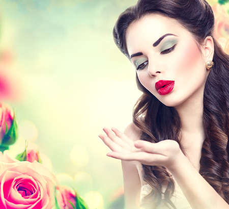 beauty make up: Retro woman portrait in pink roses garden. Vintage styled girl