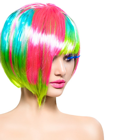 hair cut: Beauty fashion model girl with colorful dyed hair Stock Photo