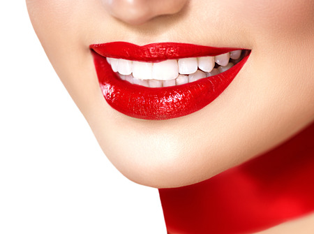 lips close up: Beautiful smiling girl with red silk scarf isolated on white