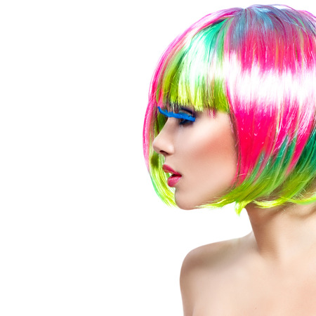 wig: Beauty fashion model girl with colorful dyed hair Stock Photo