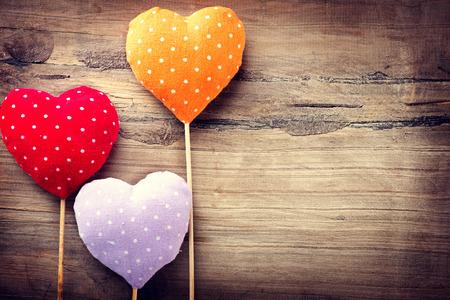 st valentin: Valentines vintage handmade hearts over wooden background Stock Photo