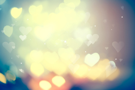 Holiday glowing blurred background. Blinking heart shaped lights Banque d'images