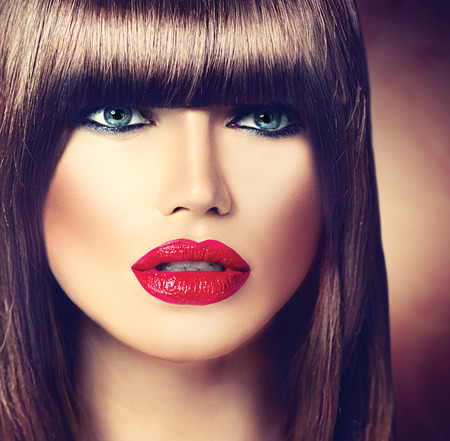 brown hair blue eyes: Beautiful brunette woman with fashion fringe haircut