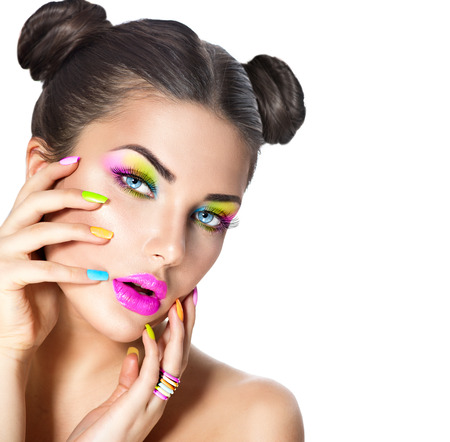 vibrant colours: Beauty girl with colorful makeup, nail polish and accessories
