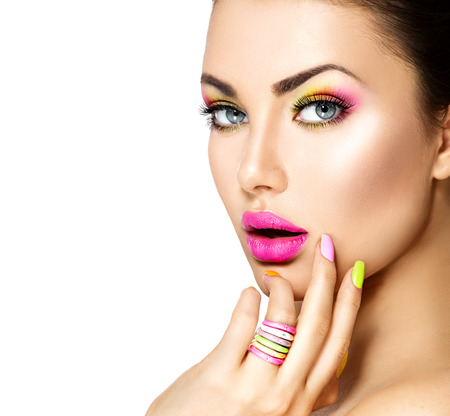 background color: Beauty girl with colorful makeup, nail polish and accessories