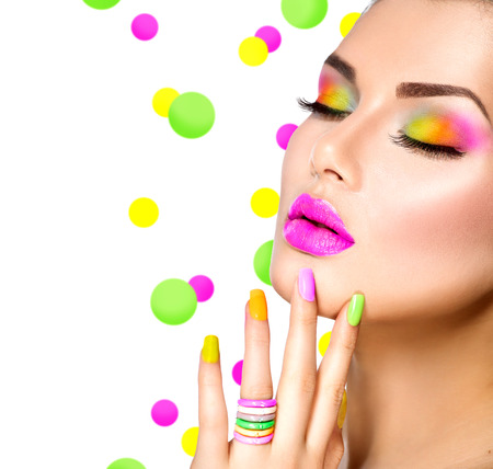 salon background: Beauty girl with colorful makeup, nail polish and accessories