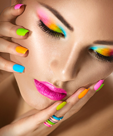 manicure: Beauty girl portrait with vivid makeup and colorful nailpolish