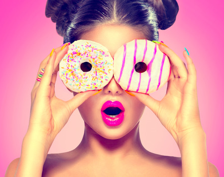 funny people: Beauty model girl taking colorful donuts. Dieting concept Stock Photo