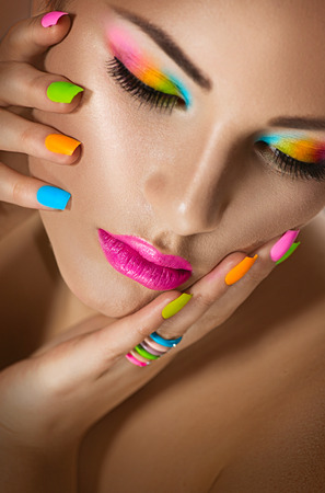 pink nail polish: Sexy girl portrait with vivid makeup and colorful nailpolish Stock Photo