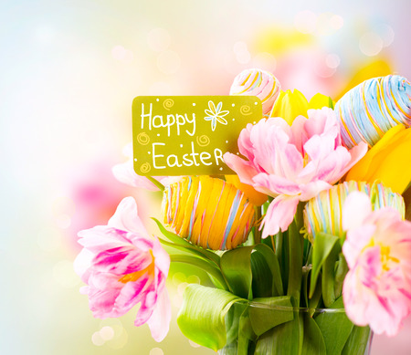 coloured background: Easter holiday flowers bunch with greeting card. Colorful tulips