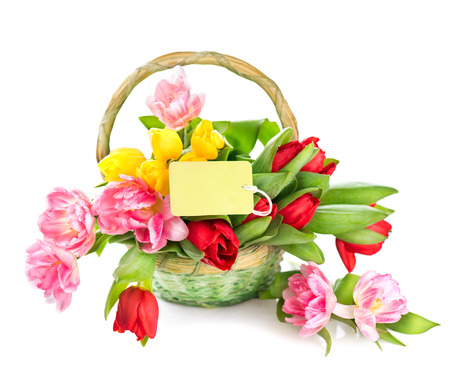 Basket of spring holiday flowers with greeting card photo