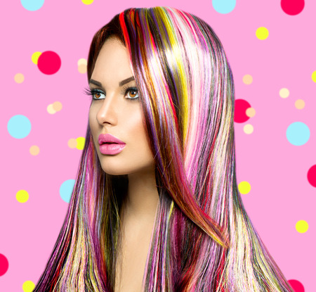 vibrant colors fun: Beauty fashion model girl with colorful dyed hair Stock Photo