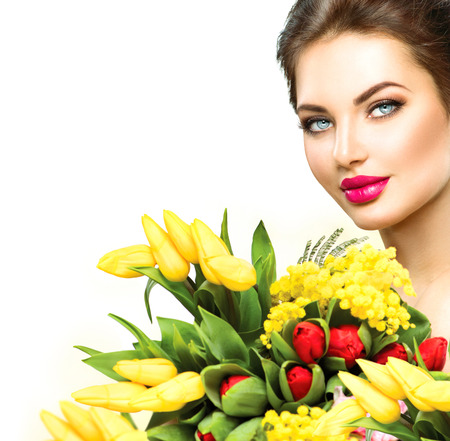 make a gift: Beauty model woman with spring flowers bouquet