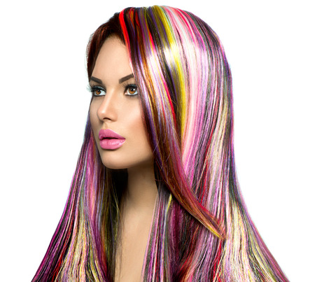 vibrant colours: Beauty fashion model girl with colorful dyed hair Stock Photo