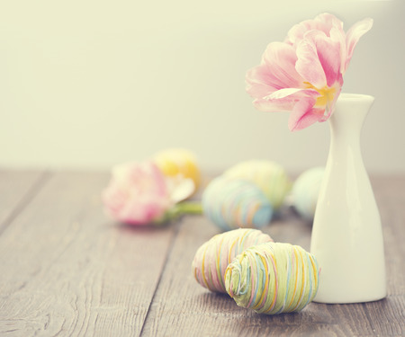 Easter photo decorated with colourful eggs and tulip flower