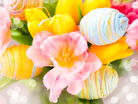 Easter holiday flowers bunch with colourful eggs photo