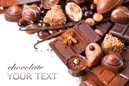 Chocolates border isolated on white background. Chocolate photo