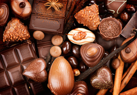 eating chocolate: Chocolates background. Praline chocolate sweets Stock Photo