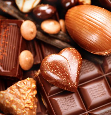 Chocolates background. Praline chocolate sweets Фото со стока