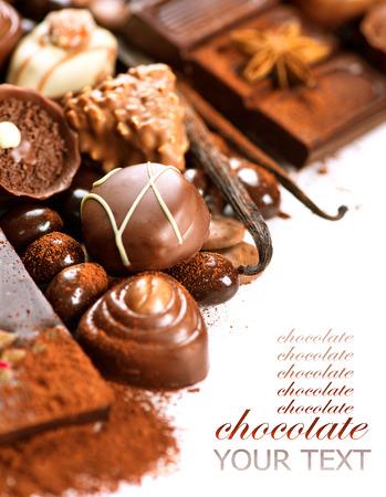 pod: Chocolates border isolated on white background. Chocolate Stock Photo