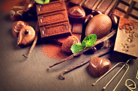 Chocolates background. Praline chocolate sweets Stock Photo