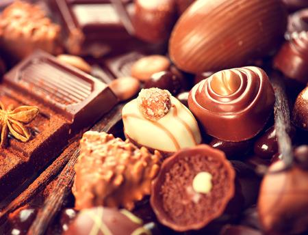 Chocolates background. Praline chocolate sweets Stock Photo