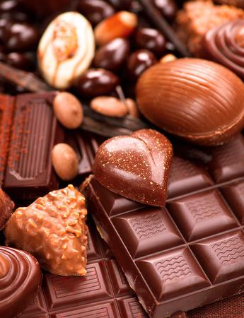 candy bar: Chocolates background. Praline chocolate sweets Stock Photo