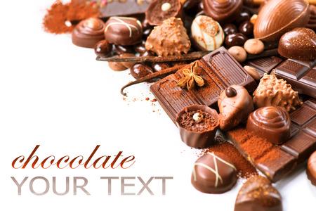 Chocolates border isolated on white background. Chocolate Foto de archivo
