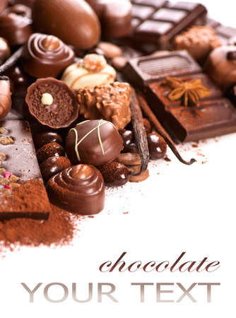Chocolates border isolated on white background. Chocolate Reklamní fotografie