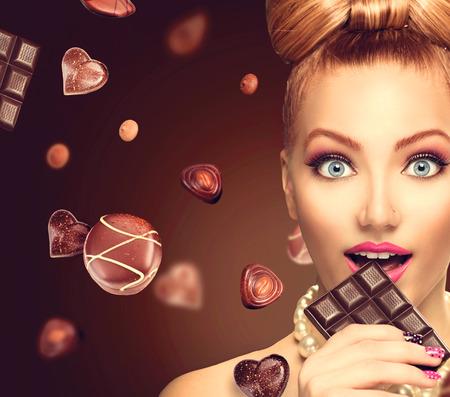 dark brown hair: Beauty fashion model girl eating chocolate