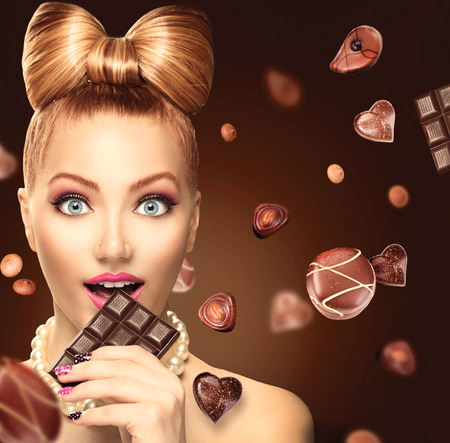 hair bow: Beauty fashion model girl eating chocolate