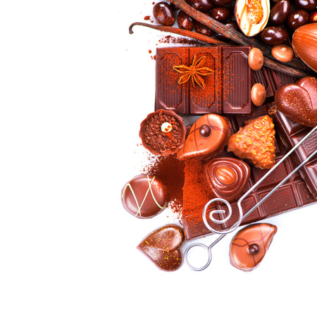 Chocolates border isolated on white. Chocolate sweets photo