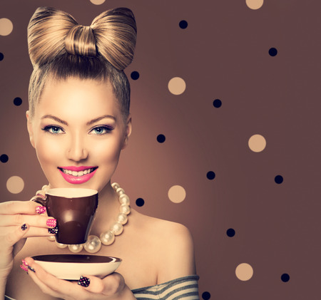 happy young woman: Beauty fashion model girl drinking coffee or tea Stock Photo