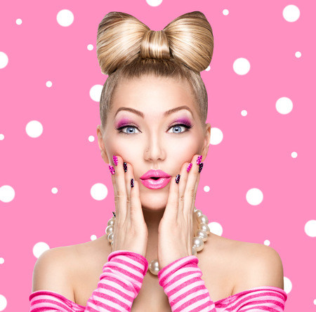 Beauty model girl with bow hairstyle over polka dots background