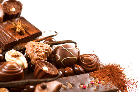 Chocolates border isolated on white background. Chocolate 스톡 콘텐츠