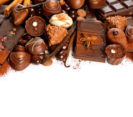 praline: Chocolate border over white. Variety of praline sweets