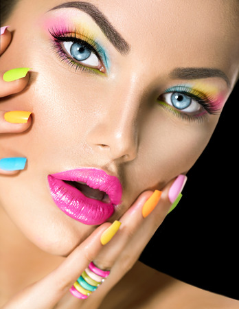 beautiful hands: Beauty girl face with vivid makeup and colorful nail polish