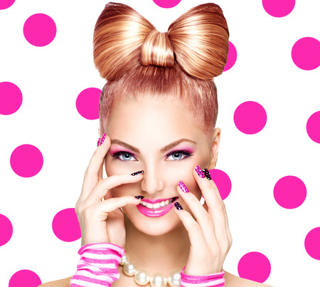 pink nail polish: Beauty fashion model girl with funny bow hairstyle