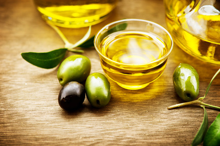 extra: Olives and olive oil. Bottle of virgin olive oil Stock Photo